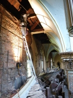 8. VA technician accesing the roof structure at the north nave