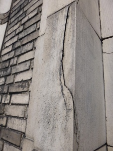 Severe crack through a terra cotta unit