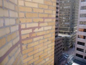 caulked mortar joints in brick masonry