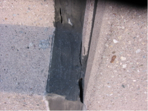 failed sealant at an expansion joint in precast concrete panels