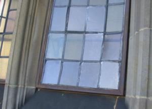 Bulged glass panes in a multi-light window