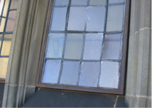 Bulged glass panes in a multi-light window
