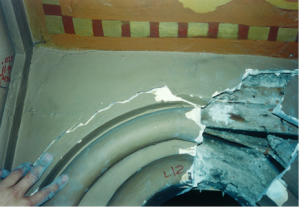 Water-damaged plaster that has separated from the substrate