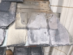 Failed fasteners and missing slates