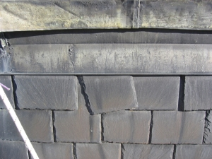 Loose slate resulting from a failed fastener